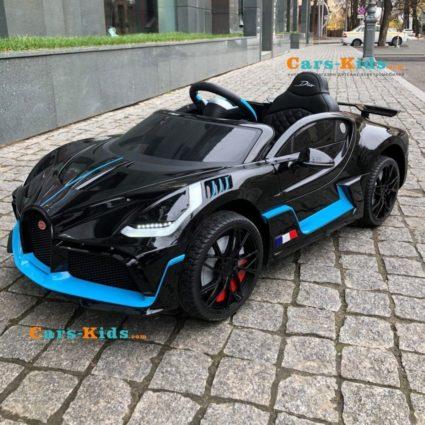Электромобиль Bugatti Divo 12V - HL338 черный (колеса резина, кресло кожа, пульт, музыка)